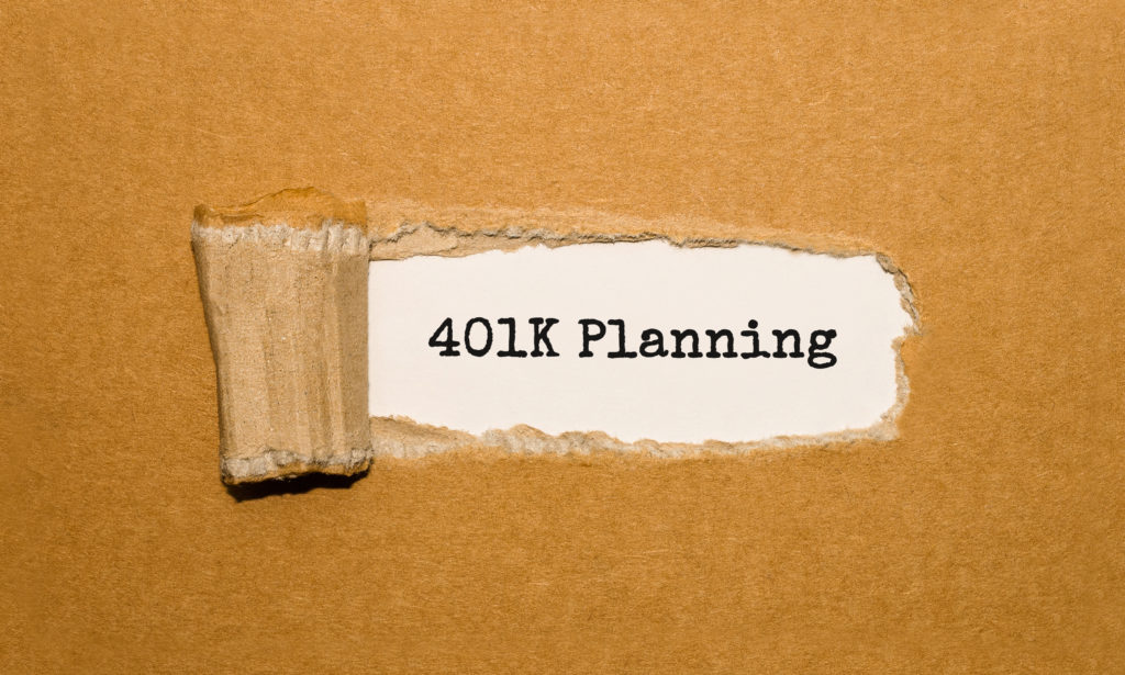 The text 401K Planning appearing behind torn brown paper