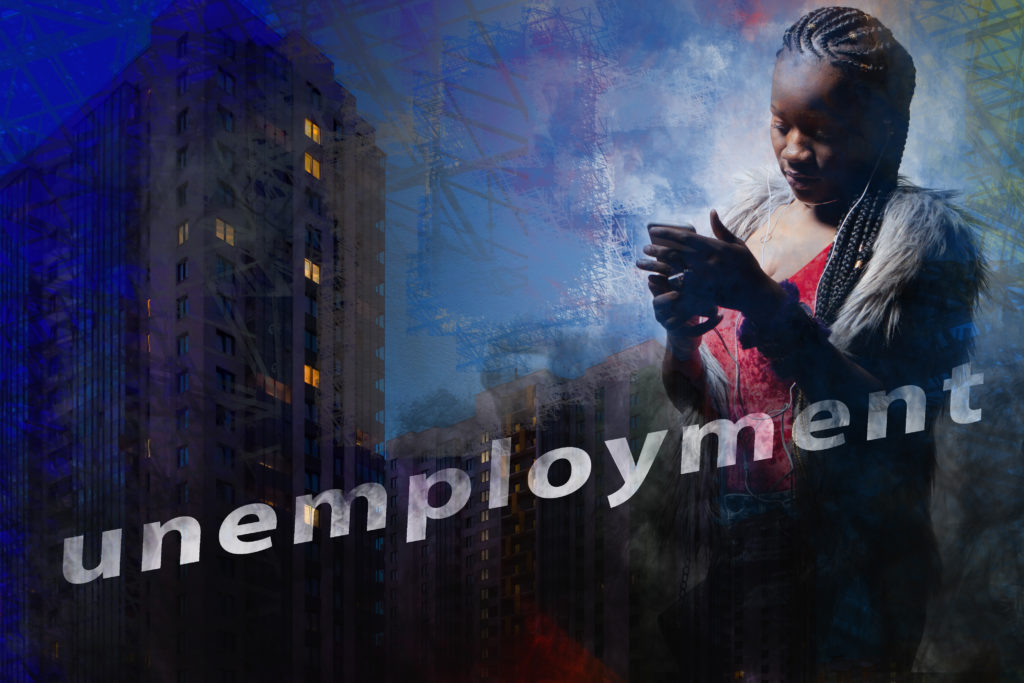 Dark-skinned girl with a mobile phone on the background of the evening city. African-American woman and the word Unemployment. A dark-skinned woman is looking for a job.