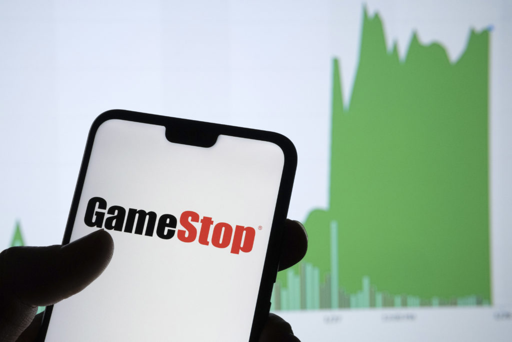 Gamestop retail company logo on the smartphone and its authentic stock price chart for the last 5 days. Stafford, United Kingdom - January 27 2021.
